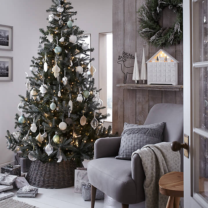Cover the branches of the silver spruce with croft decorations in